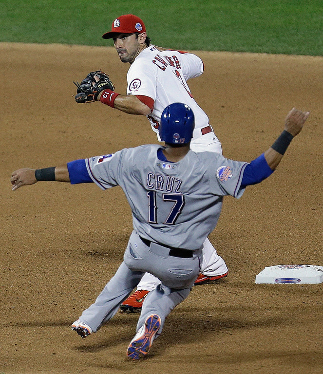 . American League\'s Nelson Cruz, of the Texas Rangers, is out at second as National Leagueís Matt Carpenter, of the St. Louis Cardinals, turns a double play on a ball hit by Edwin Encarnacion during the seventh inning of the MLB All-Star baseball game, on Tuesday, July 16, 2013, in New York. (AP Photo/Julio Cortez)