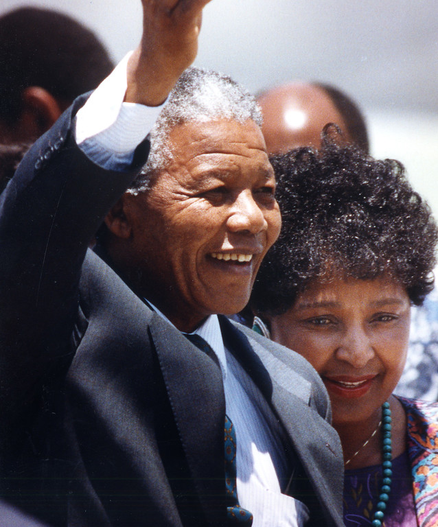 . June 1990: Nelson Mandela, with his wife, Winnie, by his side, waves to crowds on hand to greet him at Los Angeles International Airport.  Daily News file photo