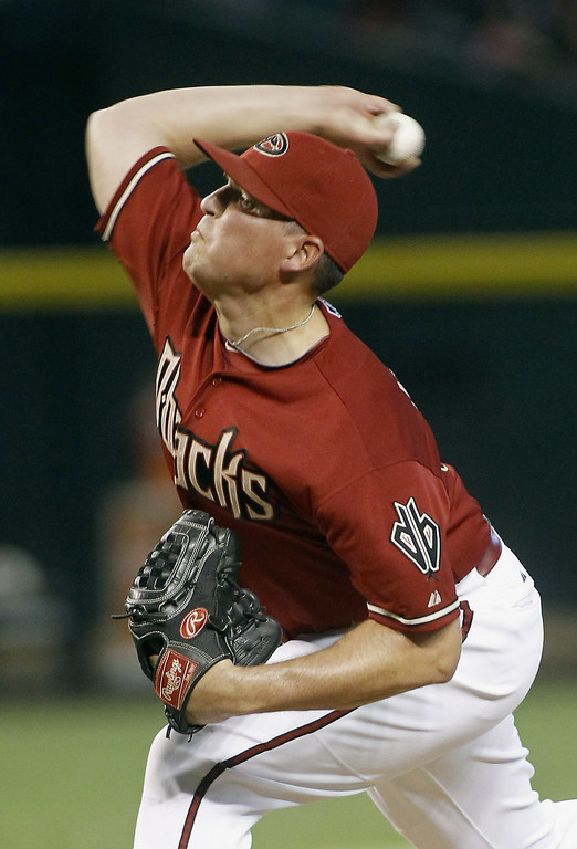 . Will Harris #38 of the Arizona Diamondbacks delivers a pitch against the Colorado Rockies during the eighth inning of a MLB game at Chase Field on August 31, 2014 in Phoenix, Arizona.  (Photo by Ralph Freso/Getty Images)