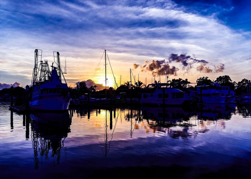 Magnificent golden colored cloud coastal sunrise image. Australia.