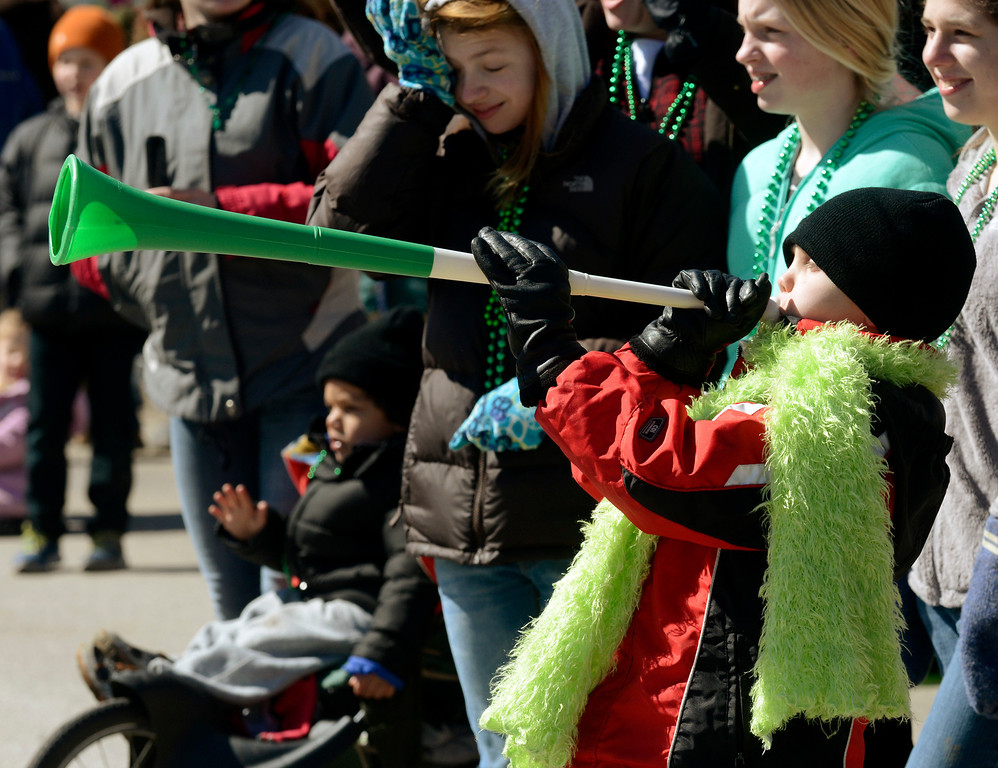 . Maribeth Joeright/MJoeright@News-Herald.com<p> Timmy Hordinski, 9, of Mentor blows his horn as participants in the 147th annual St. Patrick\'s Day parade pass by, March 17, 2014.