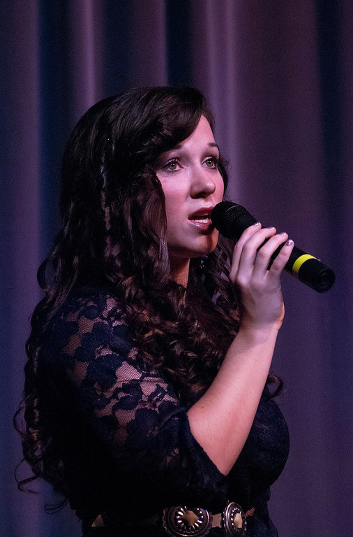 . Kayla Rice/Reformer Katelyn Donovan sings for the talent portion of the 2014 Brattleboro Winter Carnival\'s Queen\'s Pageant on Friday night.