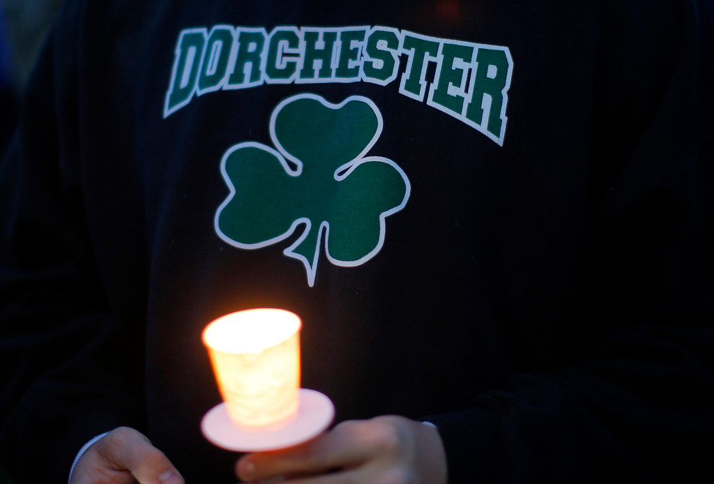 ". A man holds a candle during a candlelight vigil in the Dorchester neighborhood of Boston, Massachusetts April 16, 2013 where eight-year-old Boston Marathon explosion victim Martin Richard lived. A Little League baseball player, Martin lived in the blue Victorian house in working-class Dorchester - a Boston neighborhood dotted with ""Kids at Play\"" traffic signs and budding trees - with his parents Bill and Denise, sister Jane, 7, and brother Henry, 10. Bill Richard told the world in an email on Tuesday that his son had been killed when bombs exploded at the marathon finish line. Martin\'s mother and sister were seriously injured.   REUTERS/Brian Snyder"