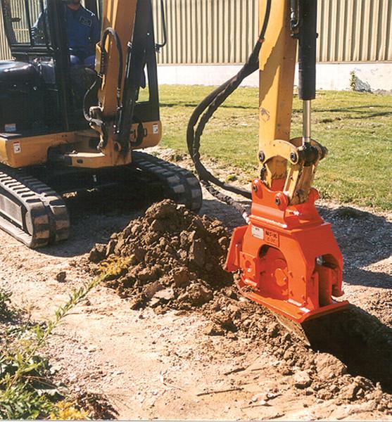 NPK C2C compactor with backfill blade on Cat mini excavator (1).jpg