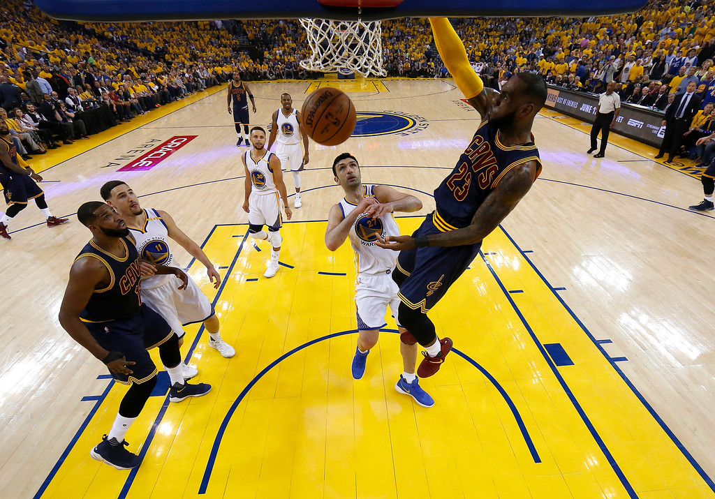 . Cleveland Cavaliers forward LeBron James (23) dunks against the Golden State Warriors during the first half of Game 1 of basketball\'s NBA Finals in Oakland, Calif., Thursday, June 1, 2017. (AP Photo/Marcio Jose Sanchez, Pool)