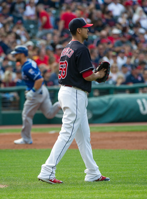 . Cleveland Indians starting pitcher Carlos Carrasco walks away from the mound as Kansas City Royals\' Alex Gordon rounds the bases after hitting a home run during the third inning of a baseball game in Cleveland, Saturday, Sept. 16, 2017. (AP Photo/Phil Long)