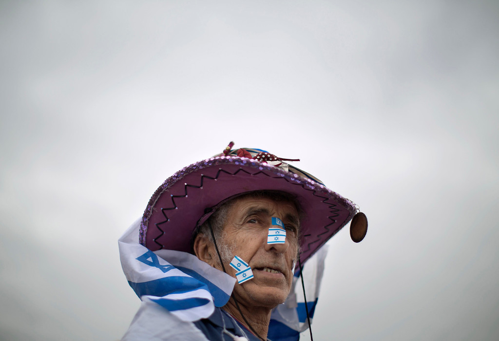 . An Israeli man attends celebrations during Independence Day in Tel Aviv, Tuesday, May 6, 2014. Israel is celebrating its annual Independence Day, marking 66 years since the founding of the state in 1948. (AP Photo/Oded Balilty)