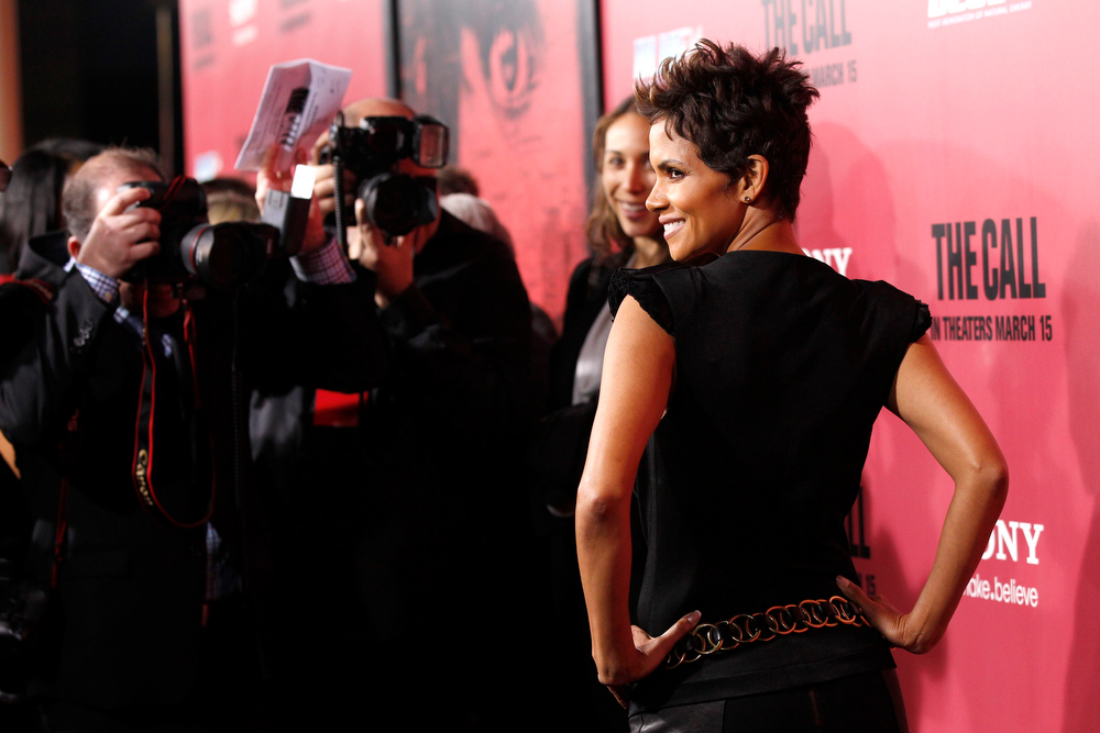 """. Cast member Halle Berry poses at the premiere of \""""The Call\"""" in Los Angeles, California March 5, 2013. The movie opens in the U.S. on March 15. REUTERS/Mario Anzuoni"""
