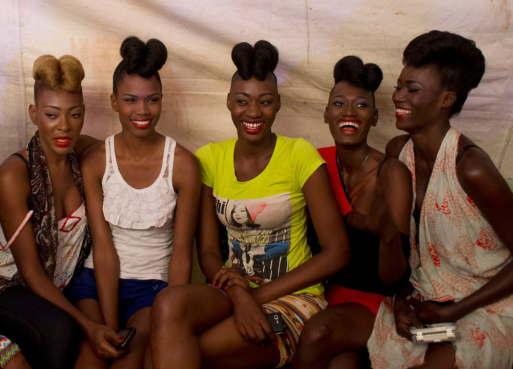 . Models pose for a picture as they wait backstage ahead of the final runway show of Dakar Fashion Week, at Hotel des Almadies in Dakar, Senegal, on Saturday, June 22, 2013. After a Friday show held in a dusty marketplace in the working class suburb of Guediawaye, the runway finale of Dakar Fashion Week was held at a luxury hotel and showcased the work of 14 designers from West Africa, Europe, South America, and the Caribbean. (AP Photo/Rebecca Blackwell)