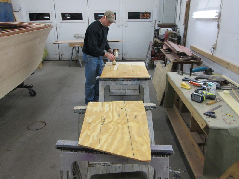 New seat backs being epoxied before being upholstered.