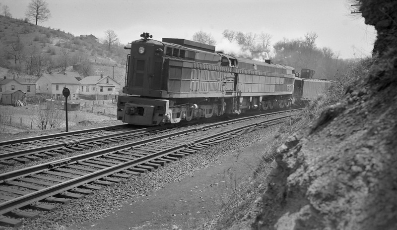 2018.15.N79.6212P--ed wilkommen 116 neg--N&W--gas-turbine locomotive 2300 on freight train--location unknown--no date