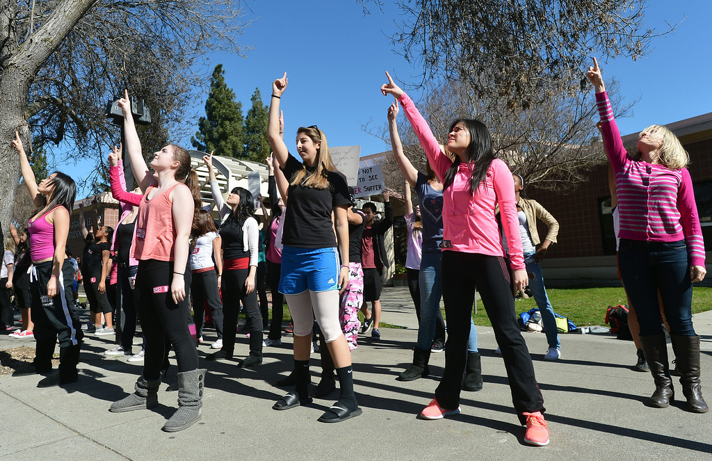 ". Women dance on the Diablo Valley College campus during a ""One Billion Rising\"" event at the college in Pleasant Hill, Calif. on Thursday, Feb. 14, 2013. \""One Billion Rising\"" is an international event to raise awareness of sexual assault and violence against women. (Kristopher Skinner/Staff)"