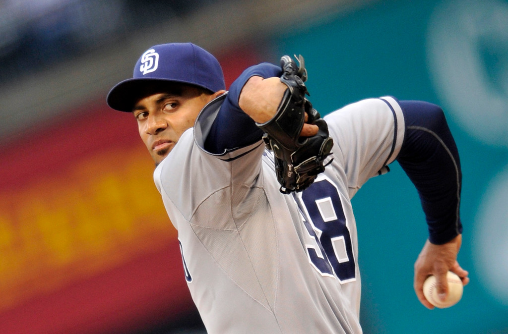 . San Diego Padres starting pitcher Tyson Ross throws to the plate against the Colorado Rockies during the first inning of a baseball game on Saturday, April 6, 2013, in Denver. (AP Photo/Jack Dempsey)