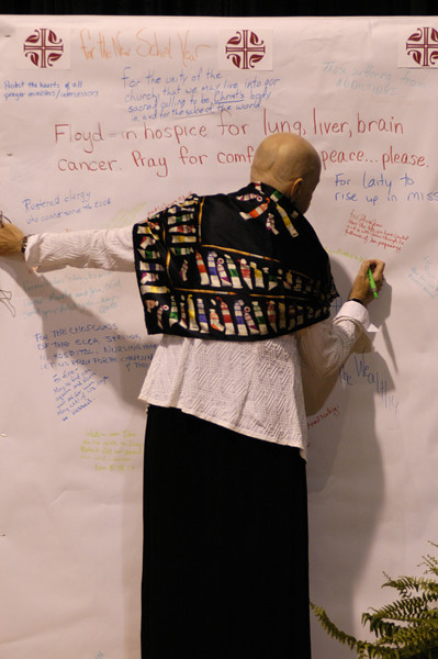 A worship service participant writes a prayer on the prayer wall during the 2007 ELCA Churchwide Assembly.