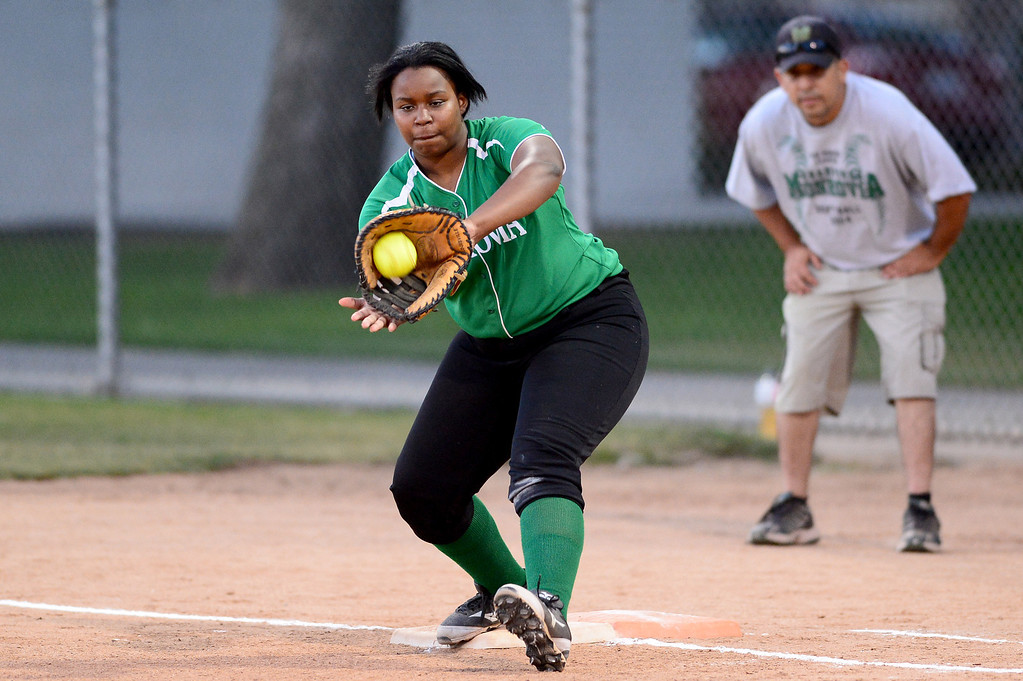 . Monrovia\'s Derek Blow (21) makes an out at first  during the West SGV softball all-star game Wednesday night, June 11, 2014 at Live Oak Park in Temple City. (Photo by Sarah Reingewirtz/Pasadena Star-News)