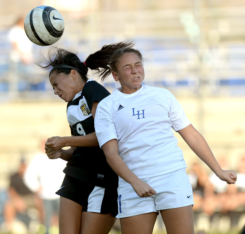 . La Habra\'s Samiya Washington (#71) leaps over Sunny Hills\' Maribell Morales (#9) for a headshot in their girls soccer game at La Habra High School on Thursday January 16, 2014. Sunny Hills defeated La Habra 2-0. (Staff Photo by Keith Durflinger/San Gabriel Valley Tribune)