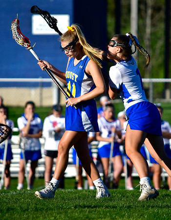 5/8/2019 Mike Orazzi | Staff Housatonic Regional's Abigail Dodge (11) and St. Paul's Gabrielle Castonguay (7) during Wednesday's girls lacrosse in Bristol.