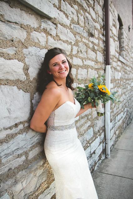 bride with sunflower bouquet