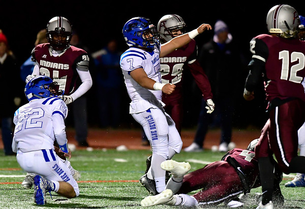 11/21/2018 Mike Orazzi | Staff Plainville's Mason Sarra (7) during Wednesday night's football game at Farmington High School.