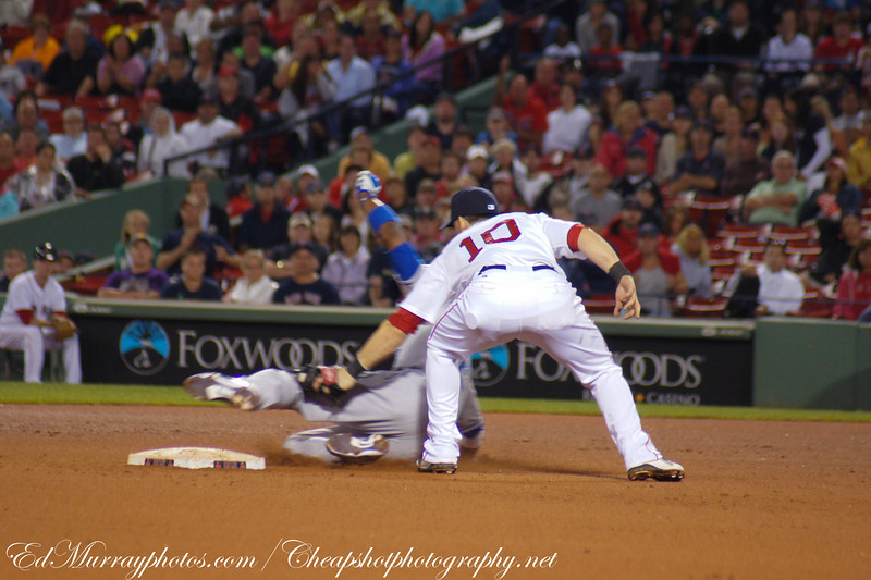 Out at second: The Red Sox Marco Scutaro applies the tag to Kansas City's Alcides Escobar.