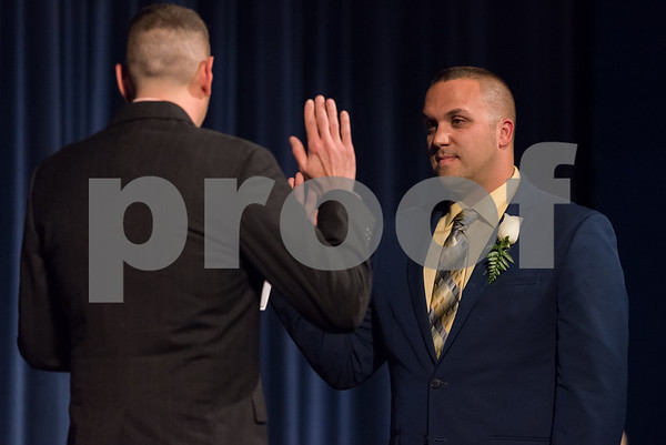 11/13/17 Wesley Bunnell | Staff The City of Bristol held their 2017 Inaugural on Monday evening at Bristol Eastern High School. Joshua Medeiros for City Council District 1 with the oath administer by Bryan Dumelin.