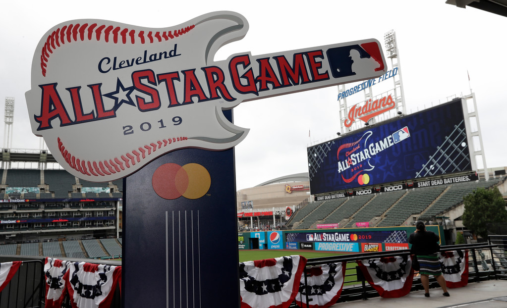. The 2019 All-Star Game logo is displayed on the concourse at Progressive Field, Tuesday, Aug. 7, 2018, in Cleveland. Indians took the rock \'n\' roll route with a logo for the 2019 All-Star Game that won\'t offend anyone. The Indians are hosting the event for the sixth time, and next year\'s game coincides with the 25th anniversary of Progressive Field. (AP Photo/Tony Dejak)