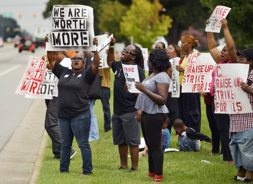 . Protesters line a portion of the 4600 block of Capitol Blvd. in Raleigh, North Carolina, at a rally calling for a $15-an-hour wage for fast-food workers, Thursday, August 29, 2013. The rally is one of several nationally. (Scott Sharpe/Raleigh News & Observer/MCT)