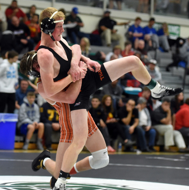 . Cole Stephenson, of Lewis-Palmer, picks up Zach Roach, of Erie, at the Gary Daum Invitational Wrestling Tournament on Saturday at Niwot High School. Cliff Grassmick  Photographer January 6, 2018