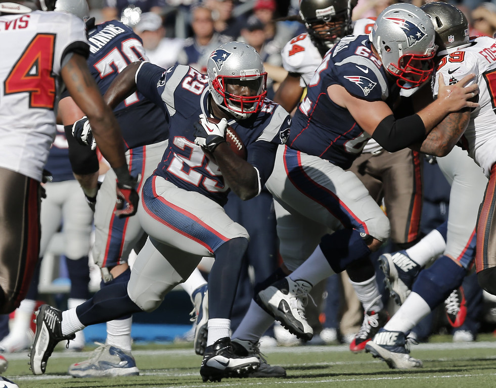. LeGarrette Blount #29 of the New England Patriots runs through an opening during the second half of their 23-3 win over the Tampa Bay Buccaneers at Gillette Stadium on September 22, 2013 in Foxboro, Massachusetts.  (Photo by Winslow Townson/Getty Images)