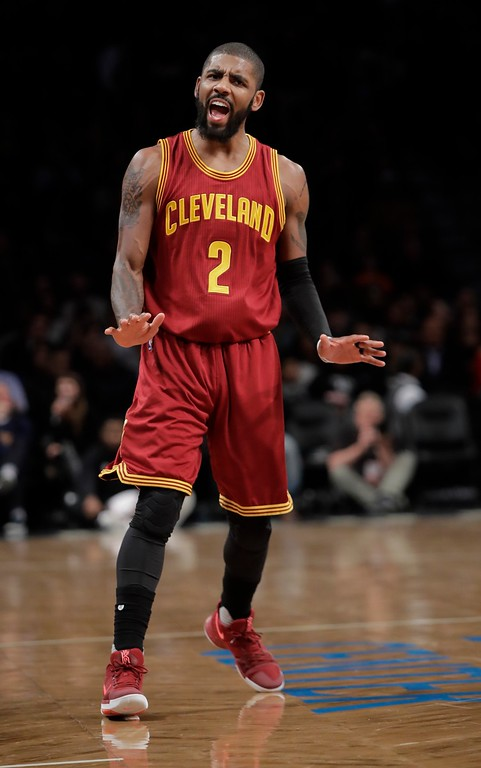 . Cleveland Cavaliers\' Kyrie Irving (2) gestures while talking to a fan after shooting a three-point basket during the first half of an NBA basketball game against the Brooklyn Nets, Friday, Jan. 6, 2017, in New York. (AP Photo/Frank Franklin II)