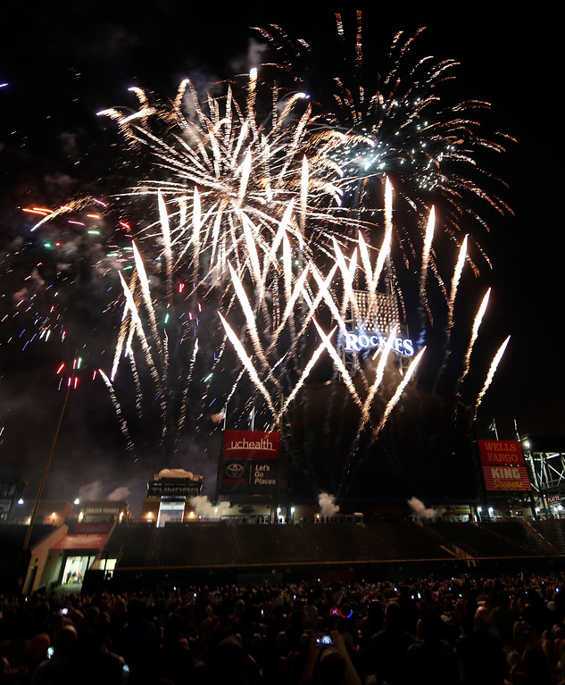 . Fireworks explode over the scoreboard in Coors Field during to mark the Independence Day holiday, after a baseball game between the San Francisco Giants and Colorado Rockies on Wednesday, July 4, 2018, in Denver. The Rockies won 1-0. (AP Photo/David Zalubowski)