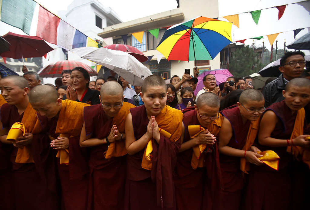 . Tibetan nuns bow as the portrait of exiled spiritual leader Dalai Lama pass by during celebrations of the 78th birthday of Dalai Lama in Kathmandu July 6, 2013. During last month\'s visit of Chinese State Councilor Yang Jiechi, Chairman of the Interim Election Council Khil Raj Regmi said Nepal is firmly committed to the One-China Policy and reaffirmed its stand that the territory of Nepal will not be allowed to be used for any activities against China. Nepal ceased issuing refugee papers to Tibetans in 1989 and recognizes Tibet to be a part of China. REUTERS/Navesh Chitrakar