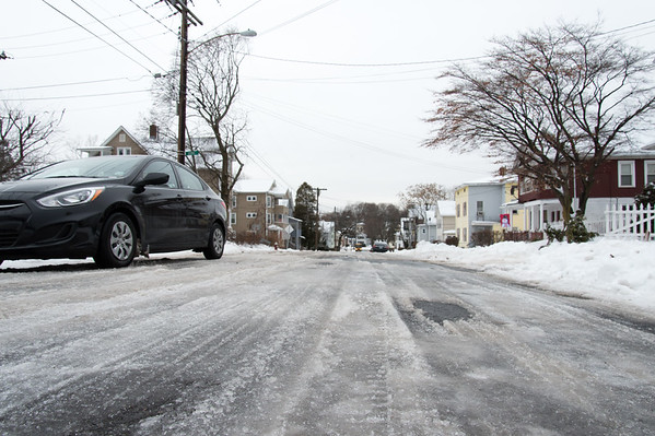 01/23/19 Wesley Bunnell | Staff Several streets and sidewalks still remain covered in snow and ice on Wednesday after a weekend storm. A look down Austin St.