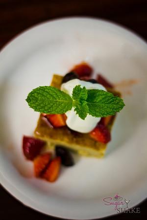 Tres Leches Cake topped with Strawberries and Maraschino Cherries. © 2012 Sugar + Shake