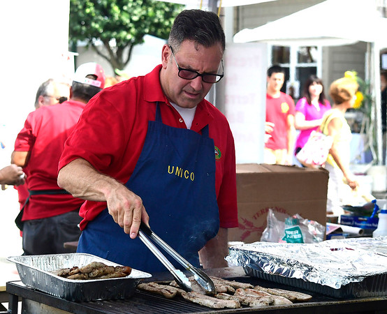 7/28/2018 Mike Orazzi | Staff UNICO's Ralph Campochiaro cooks sausage and peppers during the 14th annual Italian Festival held of Lower Center Street in Southington Saturday.