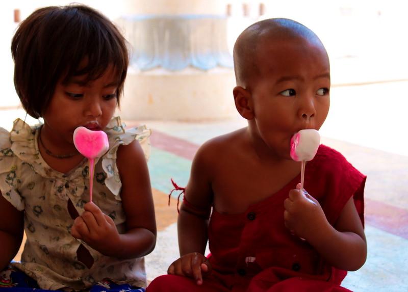 Mini monk enjoys an ice cream