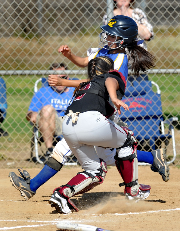 . California\'s Sierra Rodriguez (#25) gets tagged out at home by Bell Gardens\' catcher Daisy Calvary (#9) in their non-league game at California High School in Whittier on Thursday March 14, 2013. California beat Bell Gardens 10-0 in five innings. (SGVN/Staff Photo by Keith Durflinger)