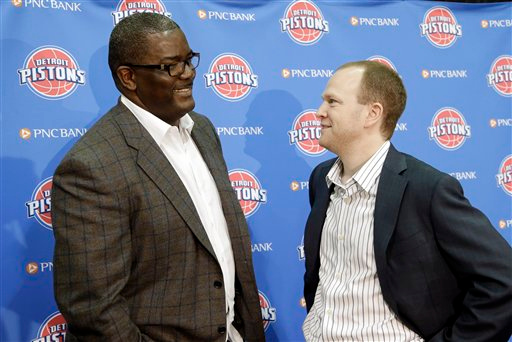 Description of . Detroit Pistons general manager Joe Dumars, left, and head coach Lawrence Frank talk after introducing draft choices in Auburn Hills, Mich., Friday, June 29, 2012. (AP Photo/Paul Sancya)