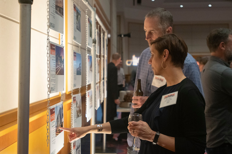 Erica Dunn and Mike Liggett of Green Hammer examine Top Project submissions. (Josh Kulla/DJC)