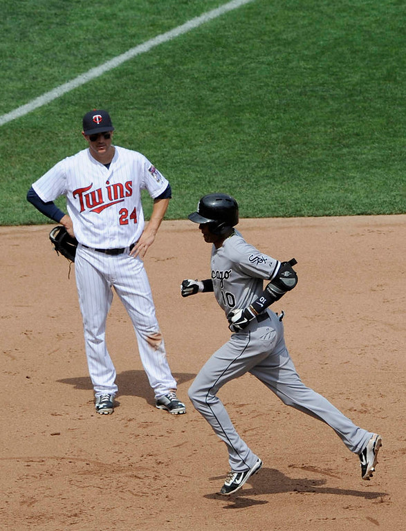 . Trevor Plouffe  of the Minnesota Twins looks on as Alexei Ramirez  of the Chicago White Sox rounds the bases after hitting a solo home run during the fifth inning. (Photo by Hannah Foslien/Getty Images)