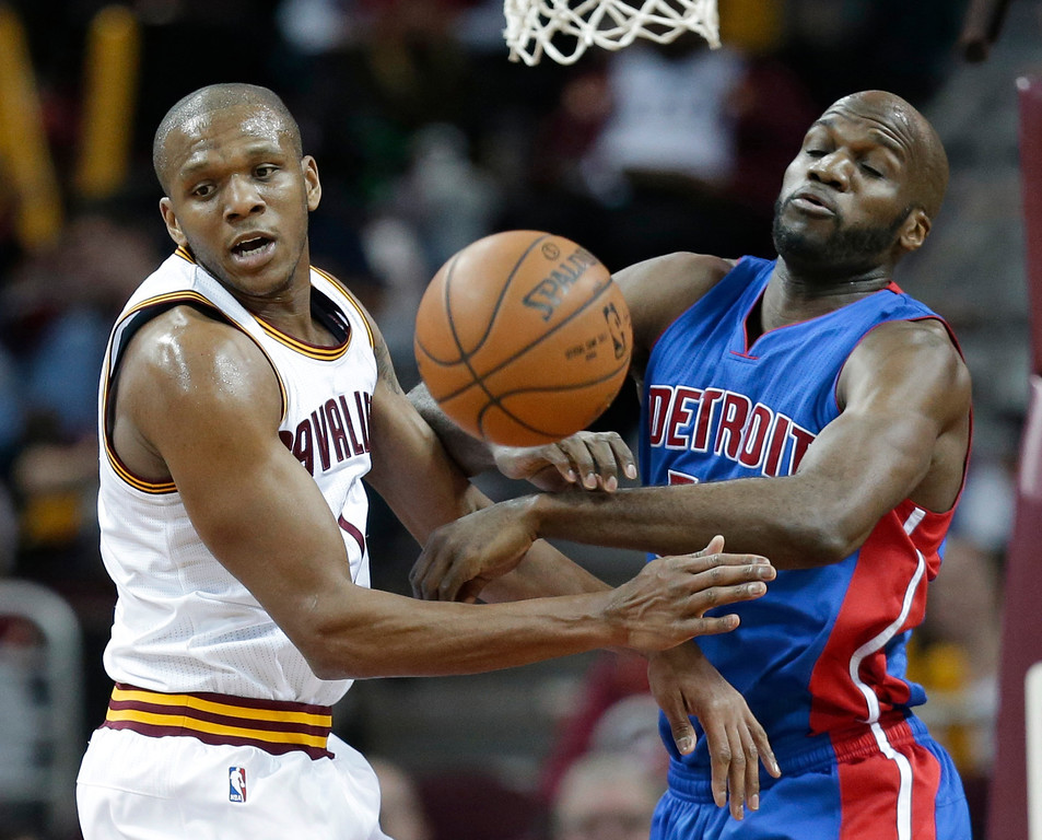 . Cleveland Cavaliers\' James Jones (1) and Detroit Pistons\' Joel Anthony (50) vie for a rebound during the first half of an NBA basketball game Wednesday, April 13, 2016, in Cleveland. (AP Photo/Tony Dejak)
