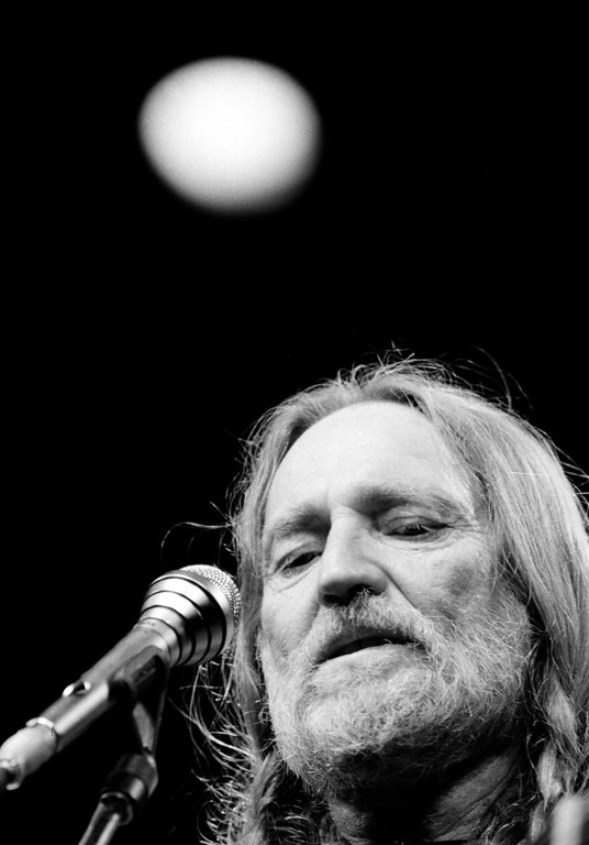 . Country singer Willie Nelson performs at New York\'s Radio City Music Hall Thursday night in the first of six sold-out concerts, May 25, 1984.  (AP Photo/Richard Drew)