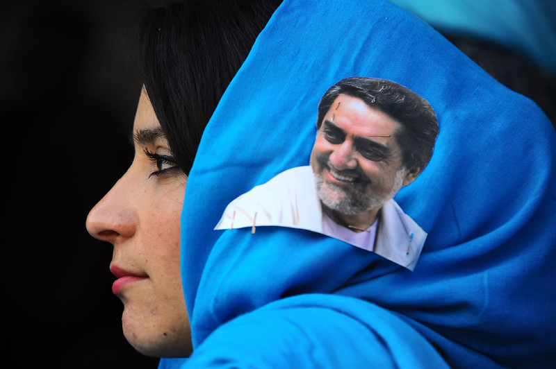 . An Afghan woman with a portrait of presidential candidate Abdullah Abdullah on her scarf listens to his speech during a campaign rally at a stadium in the northwestern city of Herat on April 1, 2014. Afghanistan will vote on April 5 to choose a successor to President Hamid Karzai and to decide the make-up of 34 provincial councils in elections seen as a benchmark of progress since the Taliban were ousted from power in 2001. (Aref Karimi/AFP/Getty Images)