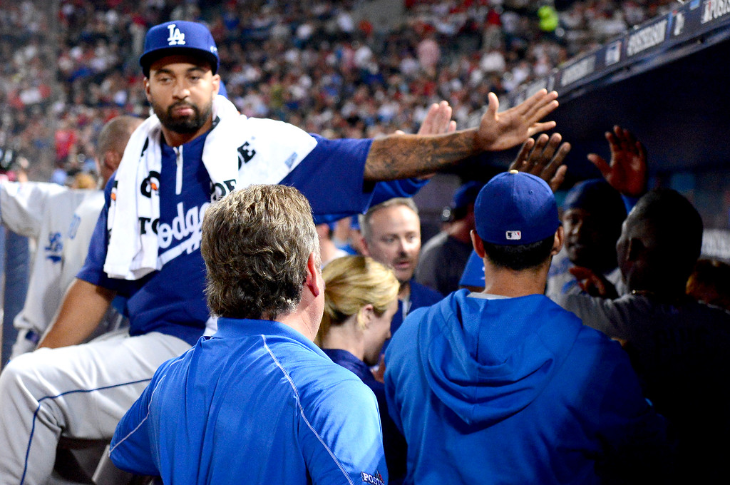 . Los Angeles Dodgers\' Matt Kemp reaches to his teammates from the bench as they defeat the Atlanta Braves 6-1 in the first game of the playoffs Thursday, October 3, 2013 at Turner Field in Atlanta, Georgia. (Photo by Sarah Reingewirtz/Pasadena Star- News)