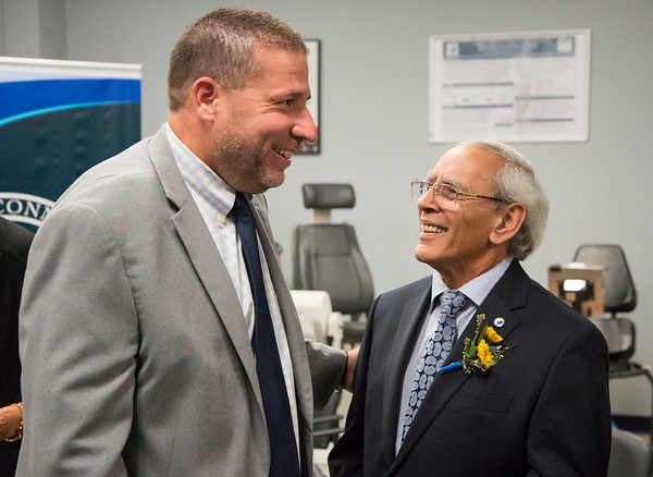 10/03/19 Wesley Bunnell | StaffrrCCSU officially opened the Dr. Antone B. Capitao Biomechanics Laboratory Classroom with a ribbon cutting on Thursday October 3, 2019. Dr. Christopher Galligan, VP Office of Institutional Advancement, L, enjoys a laugh with Dr. Capitao before the dedication.
