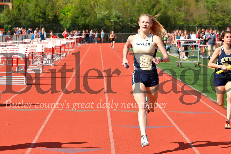 Butler's Liz Simms finishing first in the 4x800 meter. (Sizeable lead on 2nd Place NA in rear and lapping Norwin runner to the right) Simms won numerous events inlcuding 400 and 800. Seb Foltz/Butler Eagle