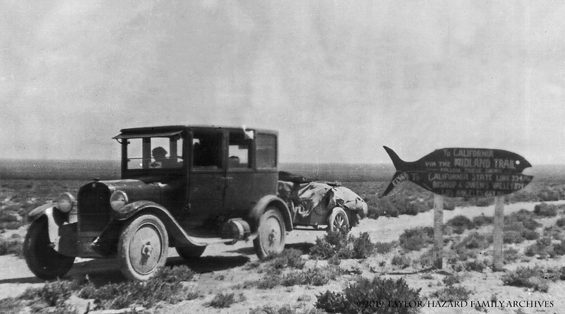 WF1923-Hazard family placing fish signs on way to Utah.jpg