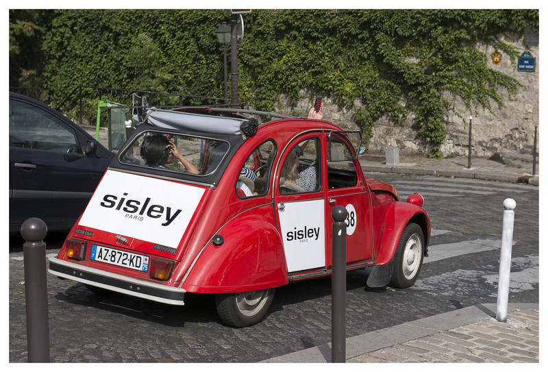 You can take tours of Paris in these vintage Citroens.  Looks like fun.  See the person holding her phone out the top?