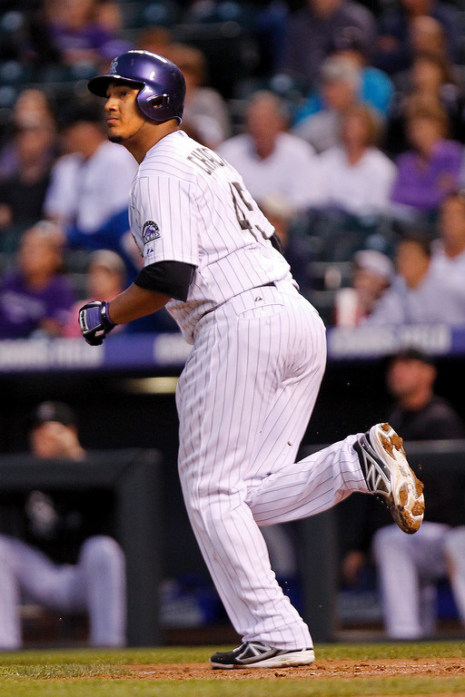 . Colorado Rockies starting pitcher Jhoulys Chacin watch his home run ball leave the park on a pitch from Arizona Diamondbacks\' Randall Delgado during the third inning of a baseball game on Friday, Sept. 20, 2013, in Denver. (AP Photo/Barry Gutierrez)