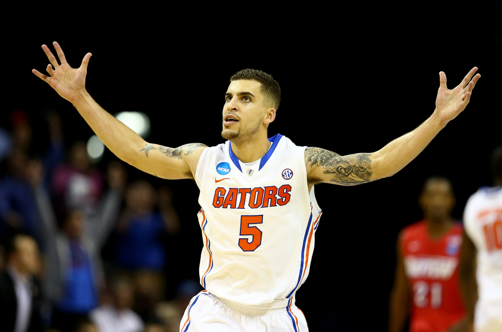 . Scottie Wilbekin #5 of the Florida Gators celebrates after hitting a three pointer to end the first half against the Dayton Flyers during the south regional final of the 2014 NCAA Men\'s Basketball Tournament at the FedExForum on March 29, 2014 in Memphis, Tennessee.  (Photo by Streeter Lecka/Getty Images)